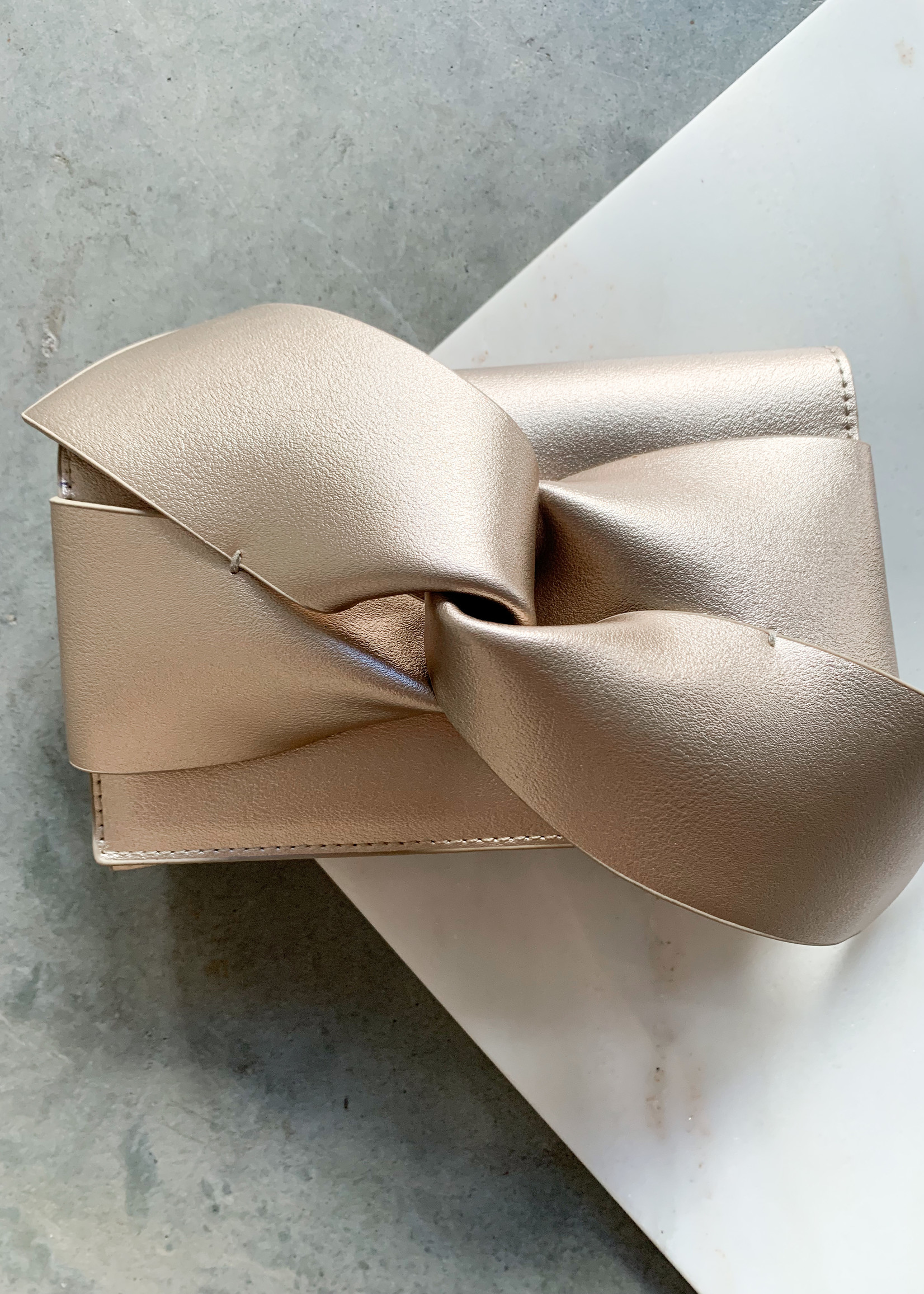 Elitaire Boutique Champagne Bow Leather Clutch
