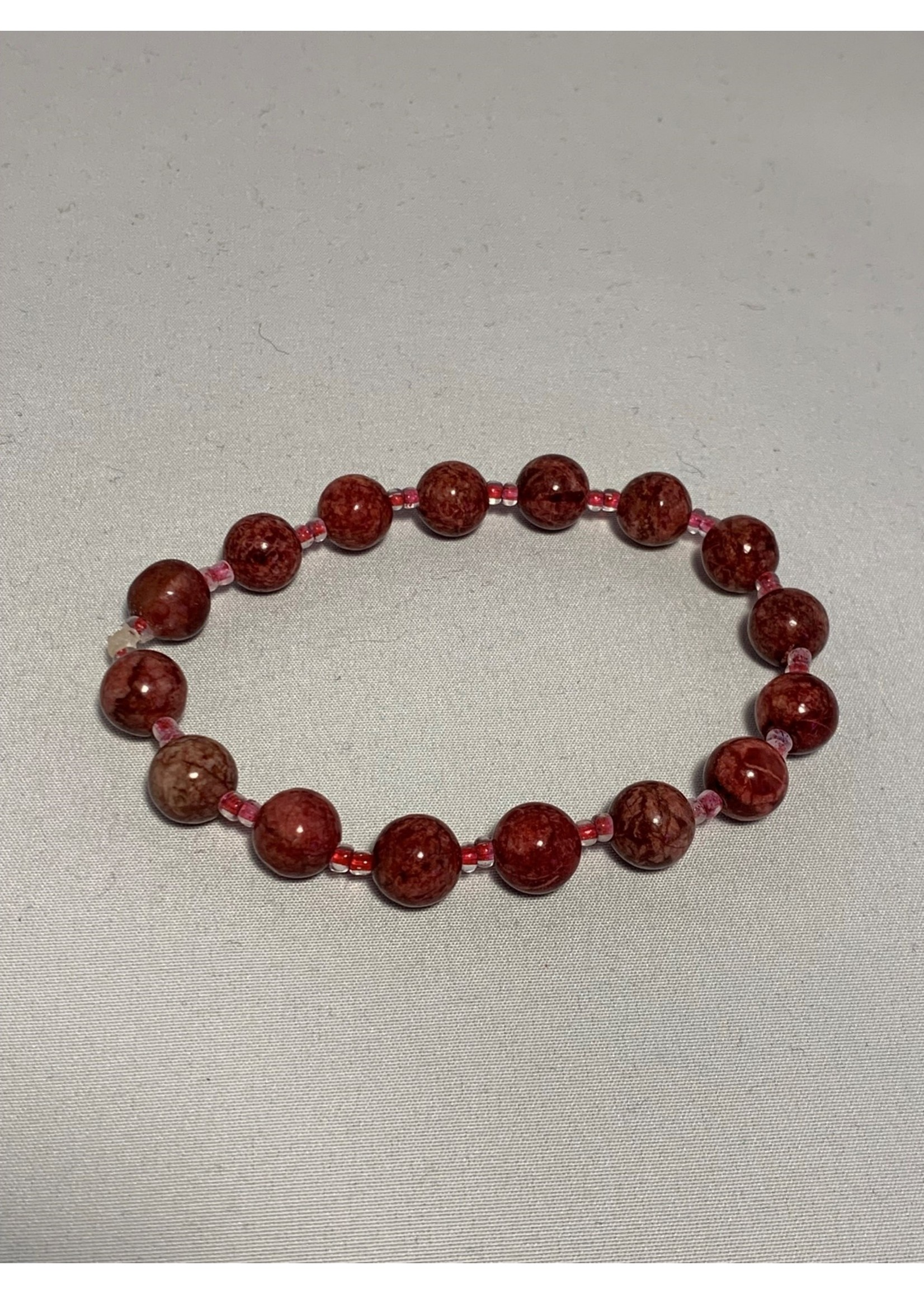 Stretch Bracelet Red Howlite with Clear Lined Red Beads