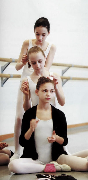 Young dancers fixing hair