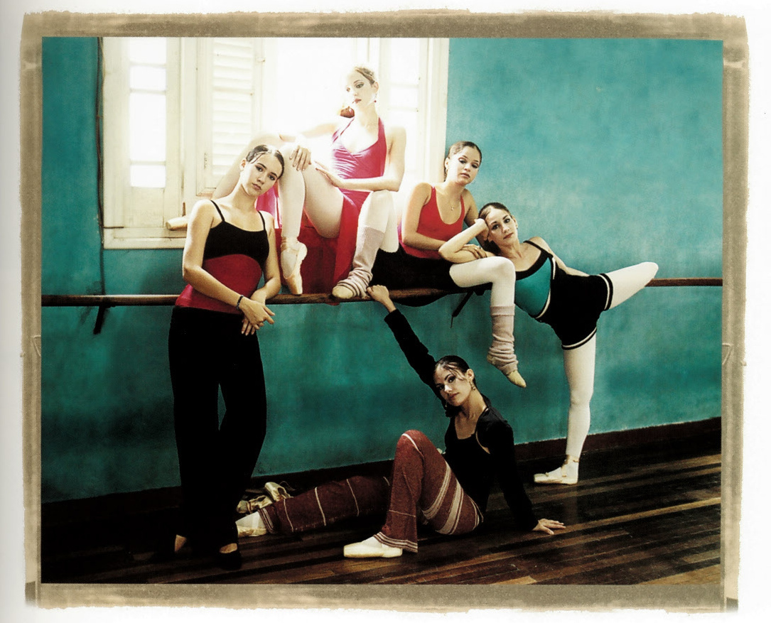 Dancers posing at the barre