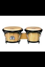 "Pearl Primero Pro Bongos – Thai Oak.  7"" + 8.5"" head diameter. Premium Buffalo heads. Contour Crown hoops and polished steel hardware. Thai Oak shell. Natural finish."