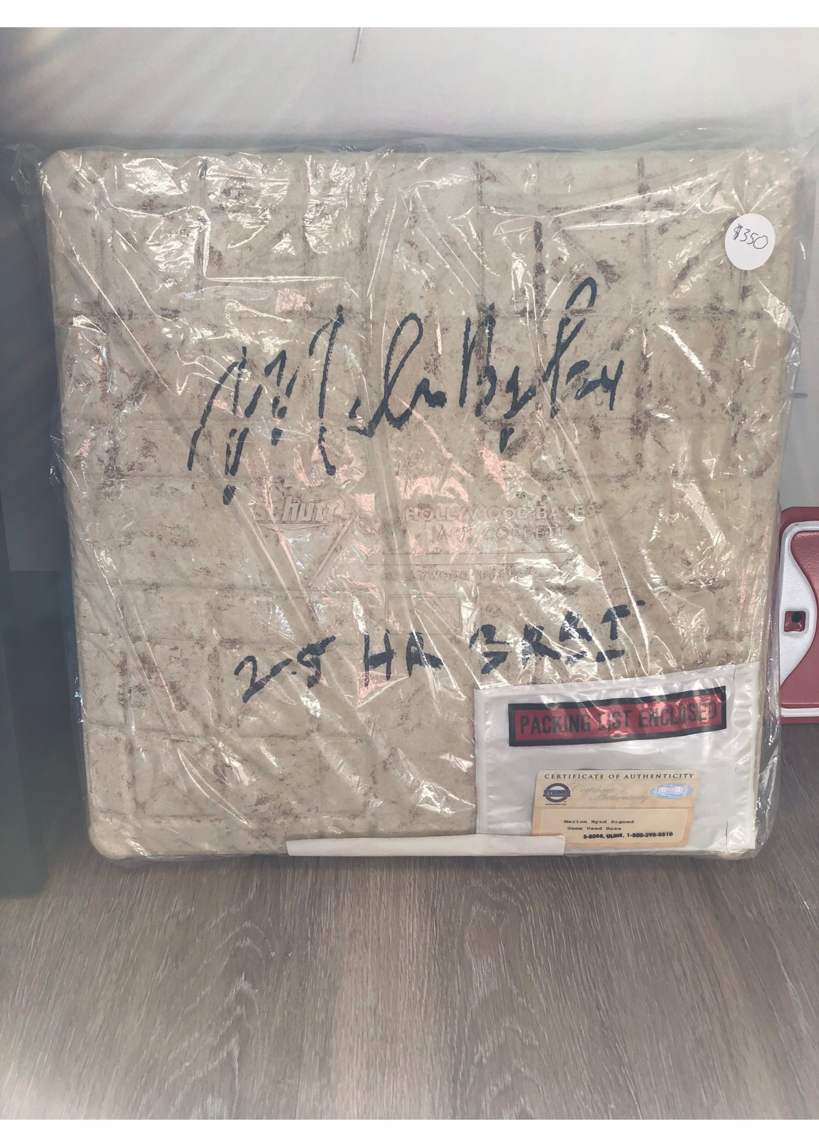 Game used base from Wrigley Field 5/2/2010 autographed by Maryln Byrd