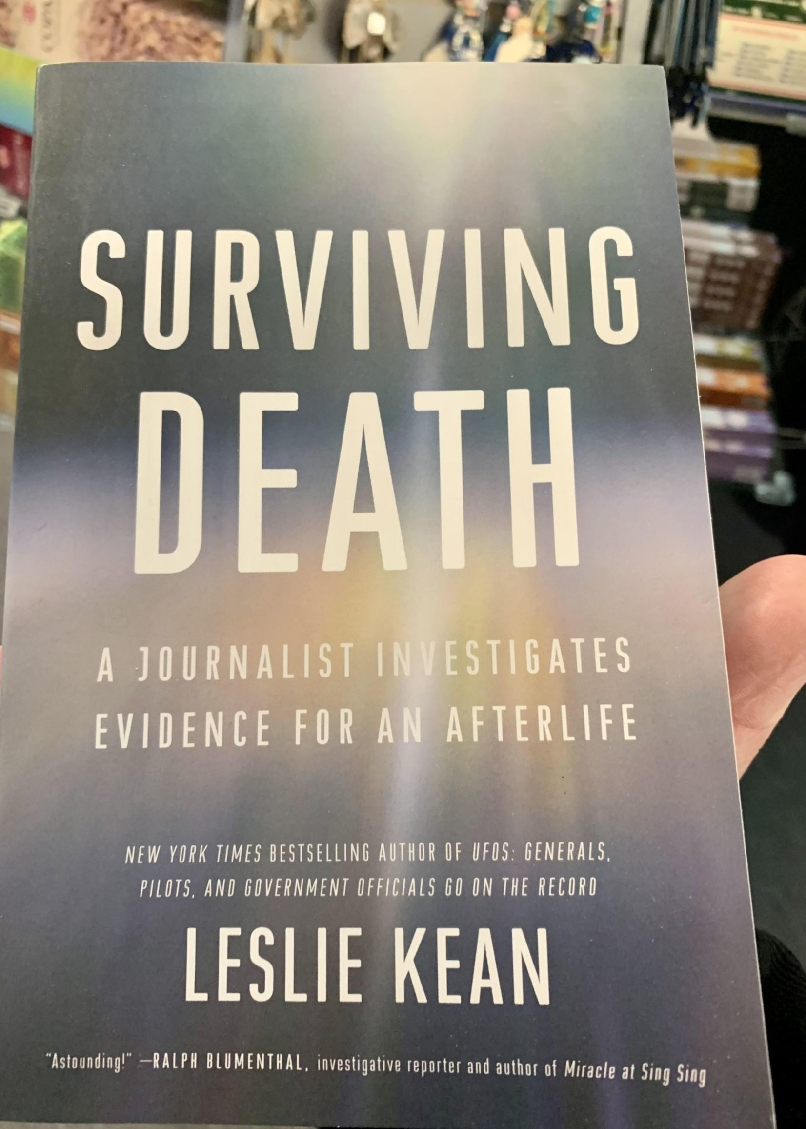 Surviving Death A JOURNALIST INVESTIGATES EVIDENCE FOR AN AFTERLIFE - By LESLIE KEAN